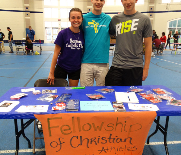 The Fellowship of Christian Athletes booth encouraged students to come to their meetings whether they were athletes or not.