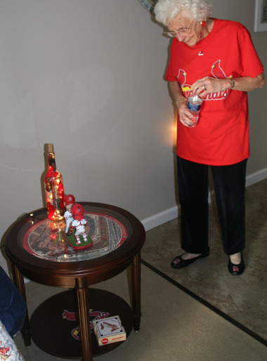 Helens table with Busch Stadium and a Cardinal winebottle light