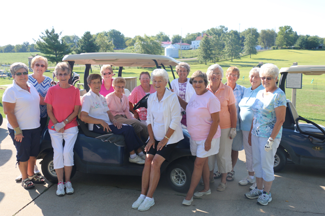 Norma Detmer (seated in the golf cart, white shirt) is surrounded by her golfing friends; the group was about to golf a round of nine holes. The ladies golf weekly, but this day was a special occasion, for it was Detmer's 90th birthday!