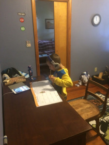 Wyatt McGraw listens to classical music while completing homework.