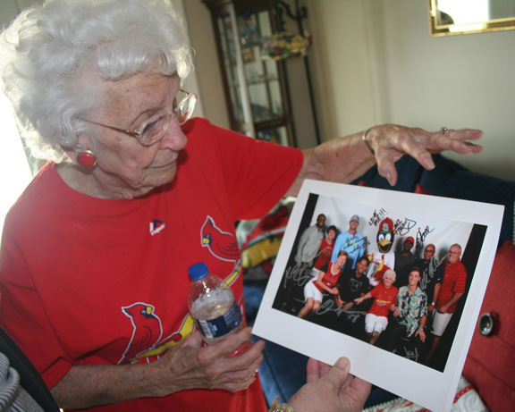 Helen shows photo of a Cardinal Cruise