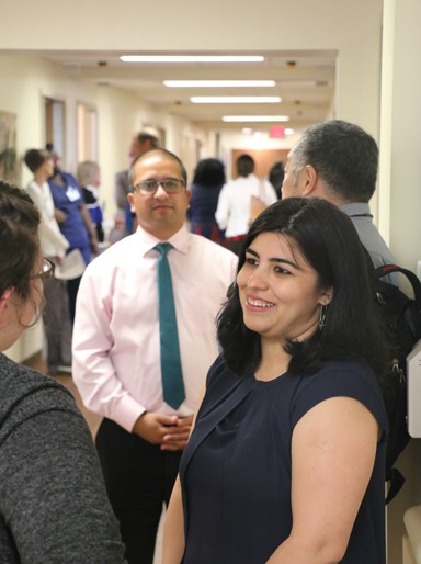 Kamna Handa, MD, The Center for Psychiatric Health (foreground) is seen talking with guests on the tour of the BHU. Pravesh Basnet, MD, Medical Director of the Behavioral Health Unit, is pictured in the background