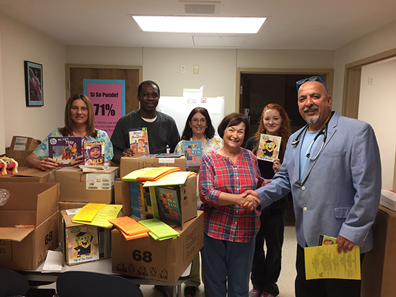 Kathy English, Dr. Royeen and staff at the Beardstown Health Department receiving the books from the literacy committee of Alpha Phi Chapter.