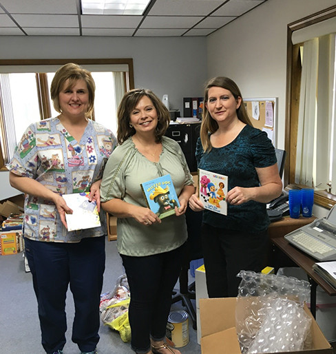Scott County Health Department staff check out their new books: Angela Hoots, Phyllis Jefferson, and Rachel Cooper.