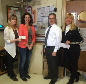 Pictured are (L-R) PTO President Michelle Douglas, Principal Kelly Zoellner, Jacksonville Rotary Club President Todd Evans, and Rotary-School liaison Linda Grojean. Douglas and Grojean presented Zoellner with checks to help fund the laminator.
