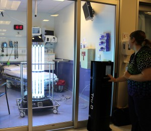 Chelsea Verticchio, Environmental Services, starts the Tru-D Robot in an Emergency Department patient room