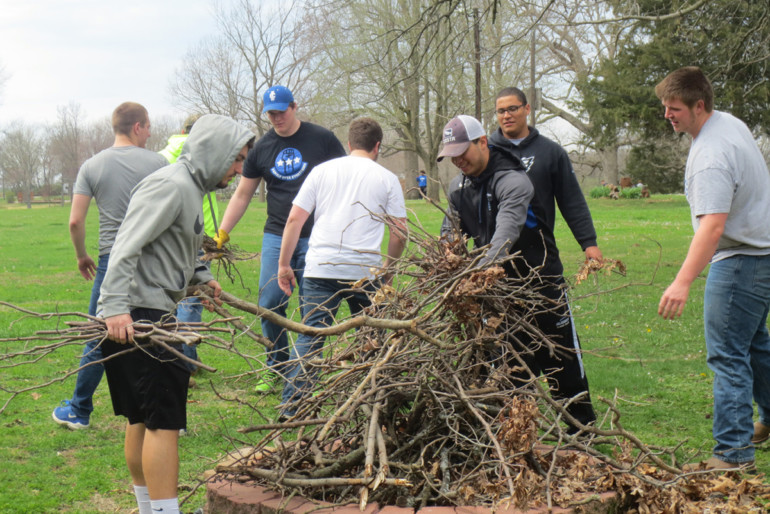 Eighty-five members from the Illinois College Football team assisted Western Illinois Youth Camp with moving furniture and boats, sweeping the cabins and picking up brush in order to help prepare the grounds for campers.