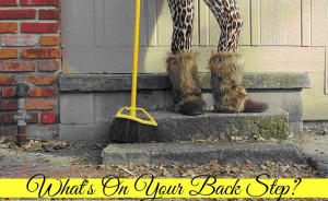 lady wearing fur boots and holding a broom