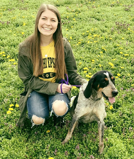 he Women of Sigma Phi Epsilon walked dogs at the Morgan County Animal Shelter.