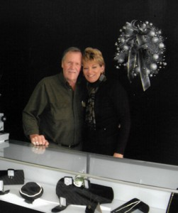 Ron Hoots and his step-daughter, Joyce Hembrough, stand by a jewelry display in years past.