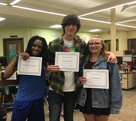 Photos/Heather Crivilare The winners of the poetry slam were, from left to right: senior Jordan Fletcher, 1st Place; junior Garret Frye, 2nd Place; and sophomore Elizabeth Hart, 3rd place, sophomore