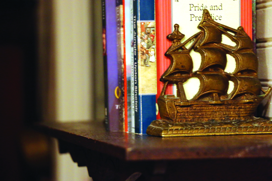 Photos/Kyla Hurt From the antique rim lock hardware and knob to a pair of brass boat bookends, details flourish within the space.