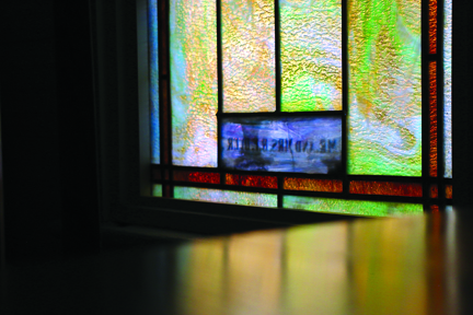 """Photos/Kyla Hurt The stained-glass windows in Bunkhouse Seventy-Four were found by Bryan Leonard. Taken from an old church in Missouri, he explains, """"They were two windows in a single case, so I had to separate them, do some repair work and place them in new, separate casings. The windows were within half an inch in size of the original window openings. Meant to be!"""""""