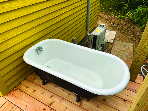 Special to The Source The outdoor soaking tub came out of a home in Iowa that was built in 1908, says Leonard.