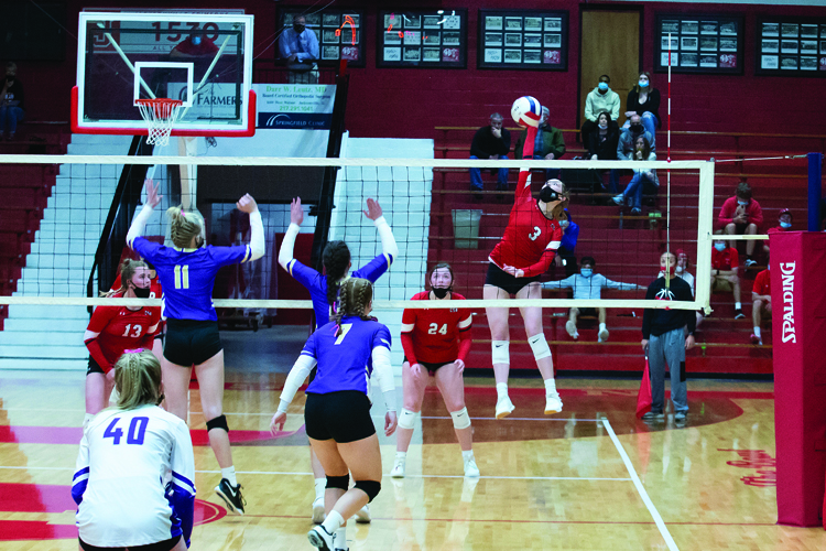 Riley Drake, sophomore and outside hitter, hammers down the ball against the Routt Catholic High School defense.