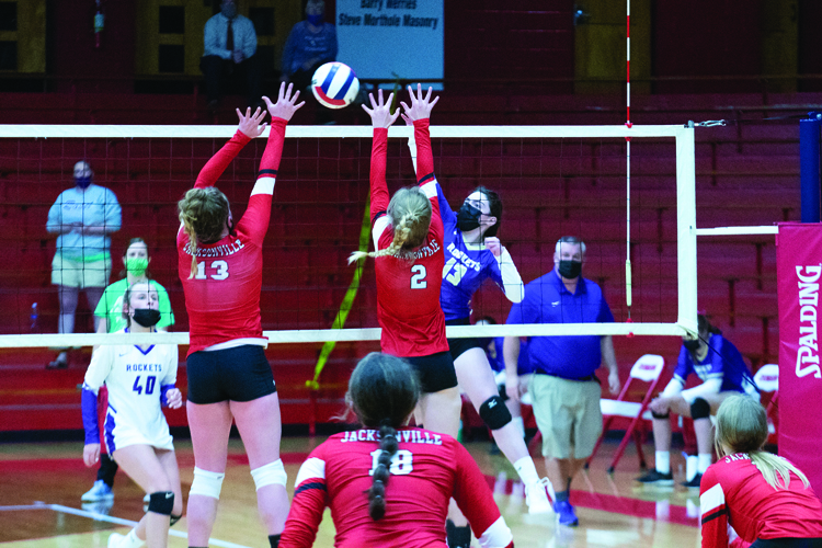 Juniors, Annika Robinson (#13) and Liz Soltermann (#2) attempt to block a hit from Routt's offensive front row during the April 12 game.