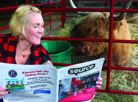 Cow reads newspaper!