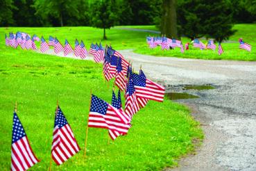AmVets, Boy Scout Troop 106 decorate Memorial Lawn Cemetery