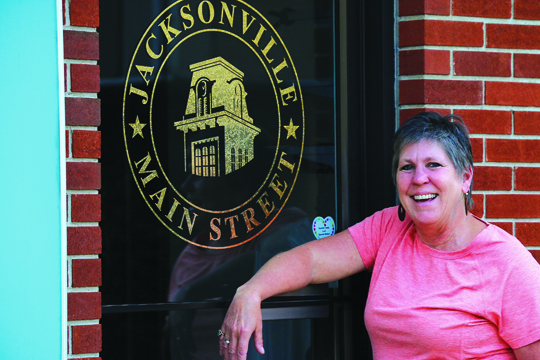 by Kyla Hurt Celebrating 20 years with JMS, Judy Tighe stands outside her office door.