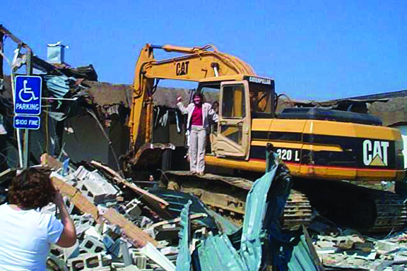 Special to The Source A proud moment for Tighe, this photo was taken after the first quad building came down in 2004.