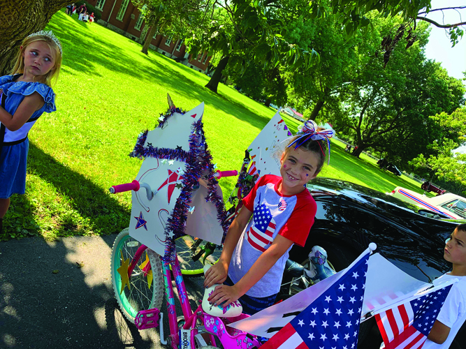The decorated bicycle participants enjoy the parade.