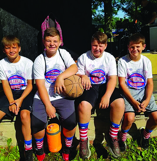 3-on-3 participants taking a break between the games. From left to right: Ian Heinemann, Braydon Tobin, Eli Pence and Carson Ford.