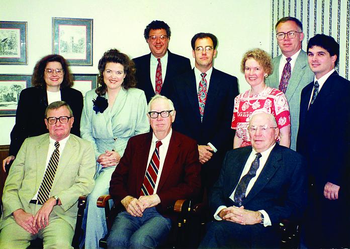 In 1995, Rammelkamp Bradney held a 100-year celebration. Seated, from left: Marc Dahman, Robert E. Bradney and Theodore C. Rammelkamp. Standing, from left: Maria M. Gonzalez, Nancy Lindsay, Larry D. Kuster, Richard Freeman, Barbara Fritsche, Forrest G. Keaton and H. Allen Yow.