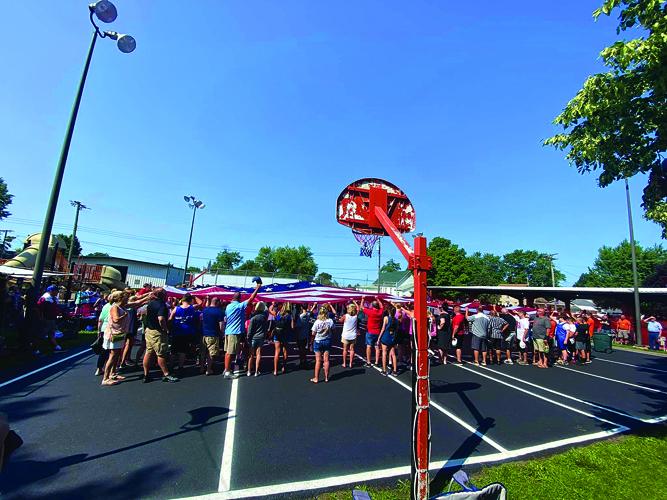 Franklin community members raise the Katy Tannahill Memorial Flag.