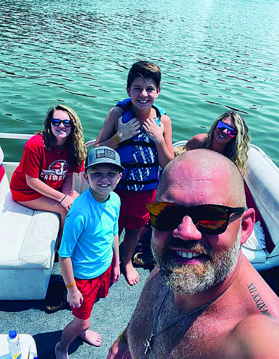 Kashton and some of the Thomas family enjoy time boating together.